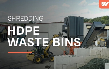 WEIMA PowerLine 2500 shreds rigid post-consumer plastics HDPE waste bins at VEOLIA in Sweden